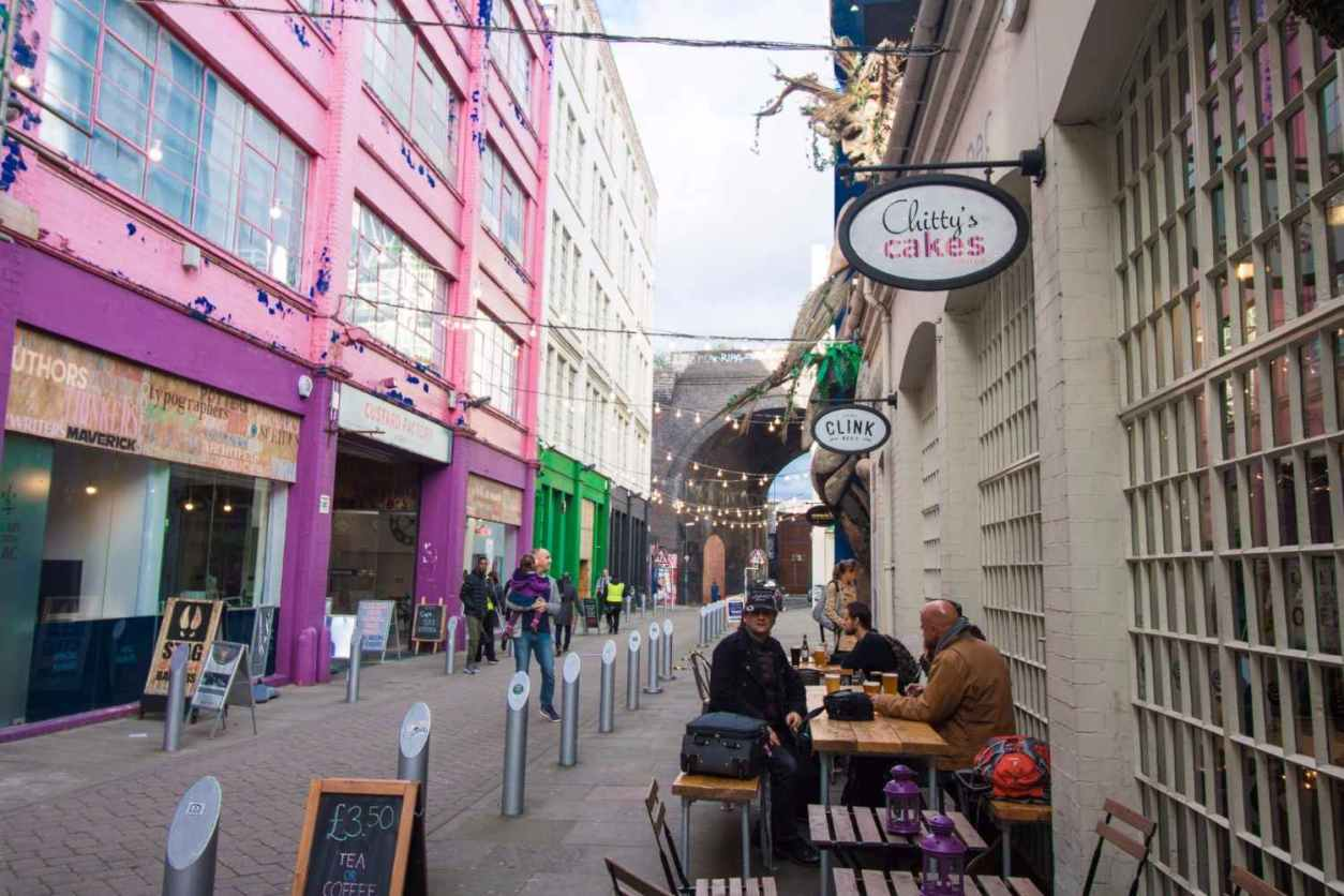 people-eating-outside-cafe-at-the-custard-factory