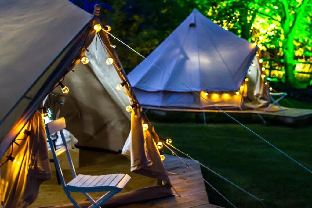 two-legan-castle-bell-tents-lit-up-at-night-glamping-kilkenny