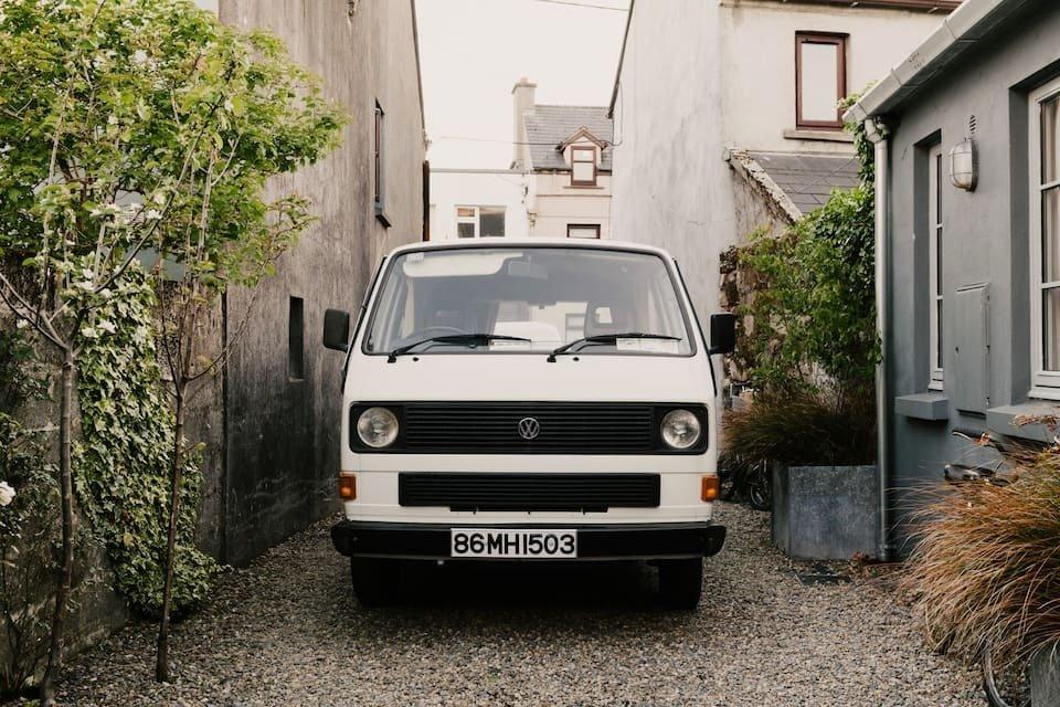 vintage-camper-van-parked-between-houses