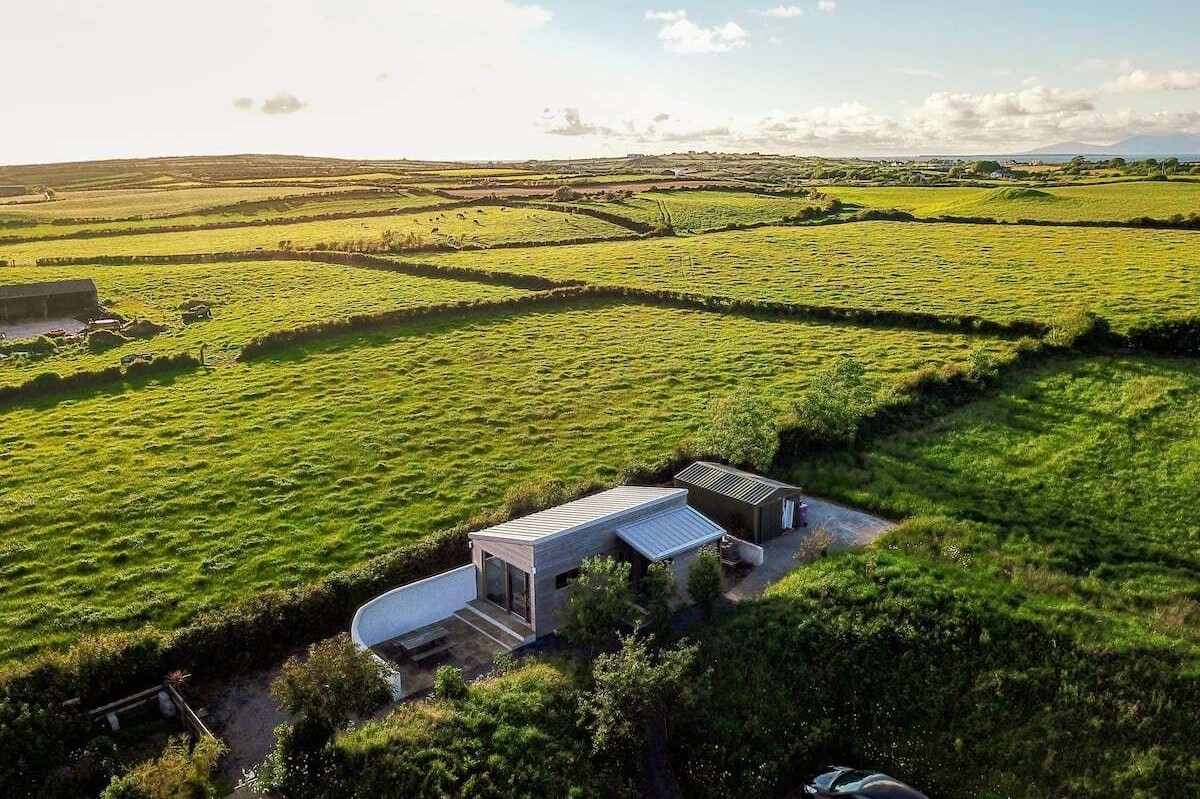 aerial-view-of-the-hide-cabin-and-fields-at-sunset