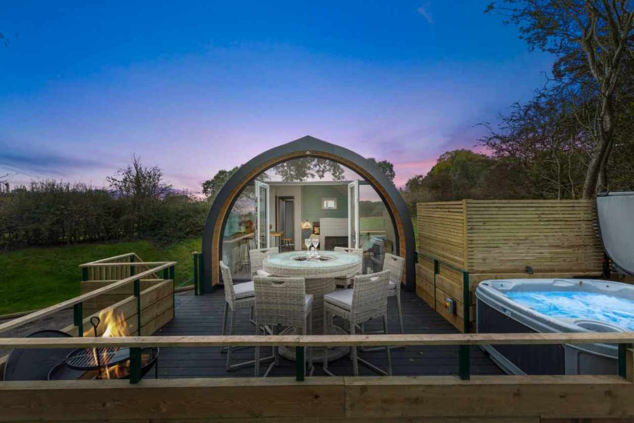 butterfly-house-pod-with-hot-tub-lit-up-at-night-glamping-derbyshire