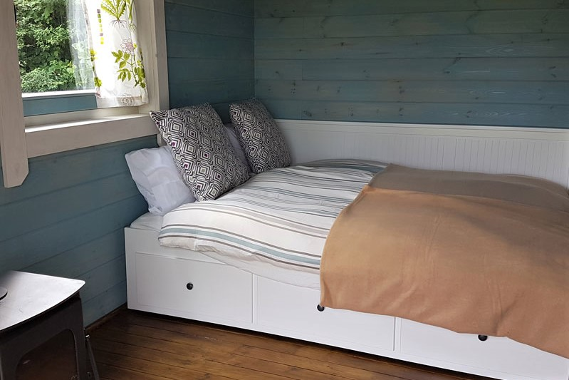double-bed-inside-alder-cabin-at-pure-camping