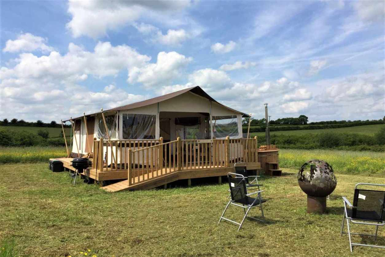 enigma-lodge-safari-tent-in-field-with-outdoor-seating-glamping-derbyshire