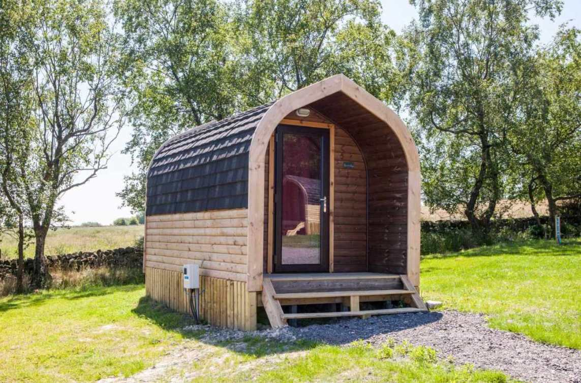 ernests-retreat-pod-in-field-on-sunny-day