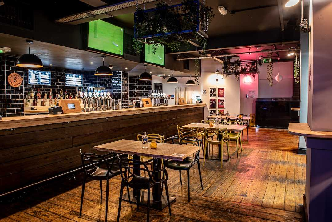 interior-of-brickhouse-social-with-tables-by-bar