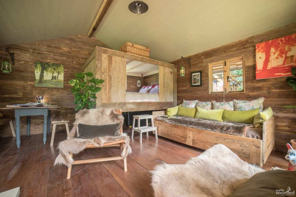 living-room-and-bedroom-of-lazy-bear-hideaway-cabin