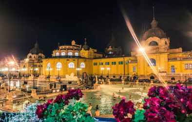 people-bathing-in-szechenyi-spa-and-baths-at-night