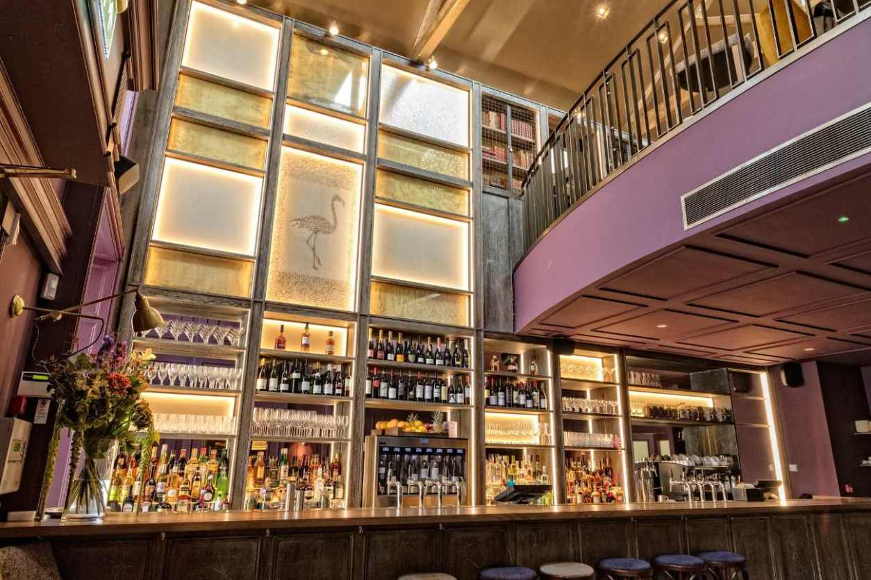 bar-and-balcony-inside-the-clarence-social