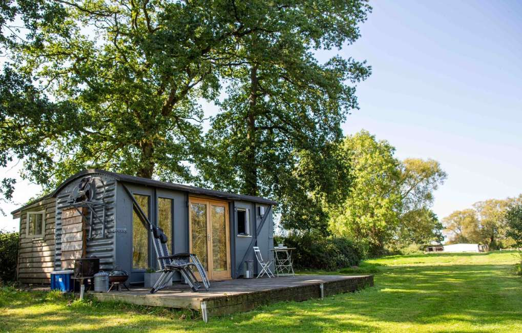 converted-railway-wagon-with-decking-in-field-glamping-gloucestershire