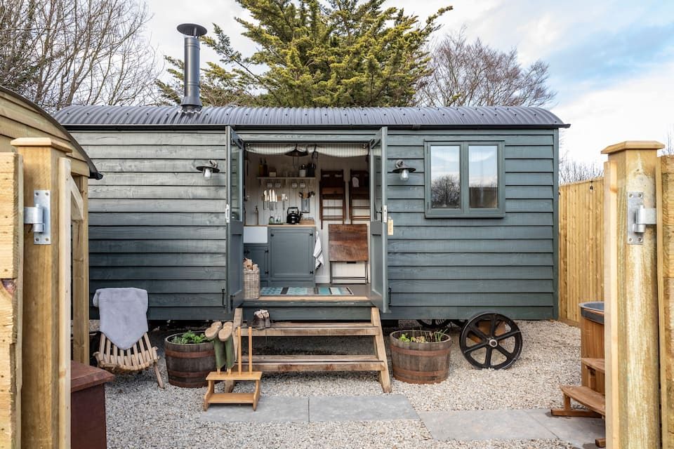 exterior-of-grey-hut-in-the-vines-shepherds-hut-glamping-kent