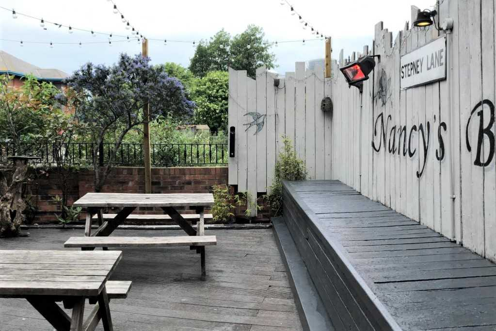 outdoor-seating-on-nancys-bordello-terrace