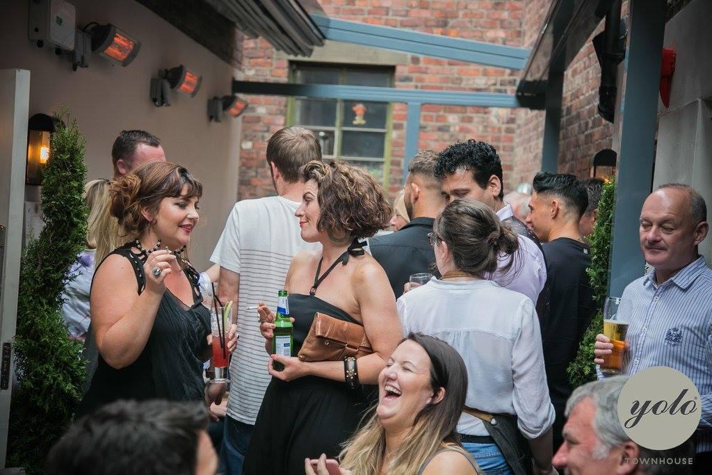 people-drinking-on-yolo-townhouse-roof-terrace