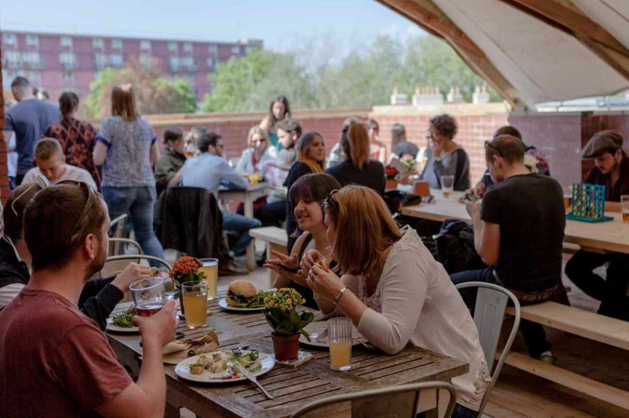 people-eating-on-the-market-assembly-roof-terrace