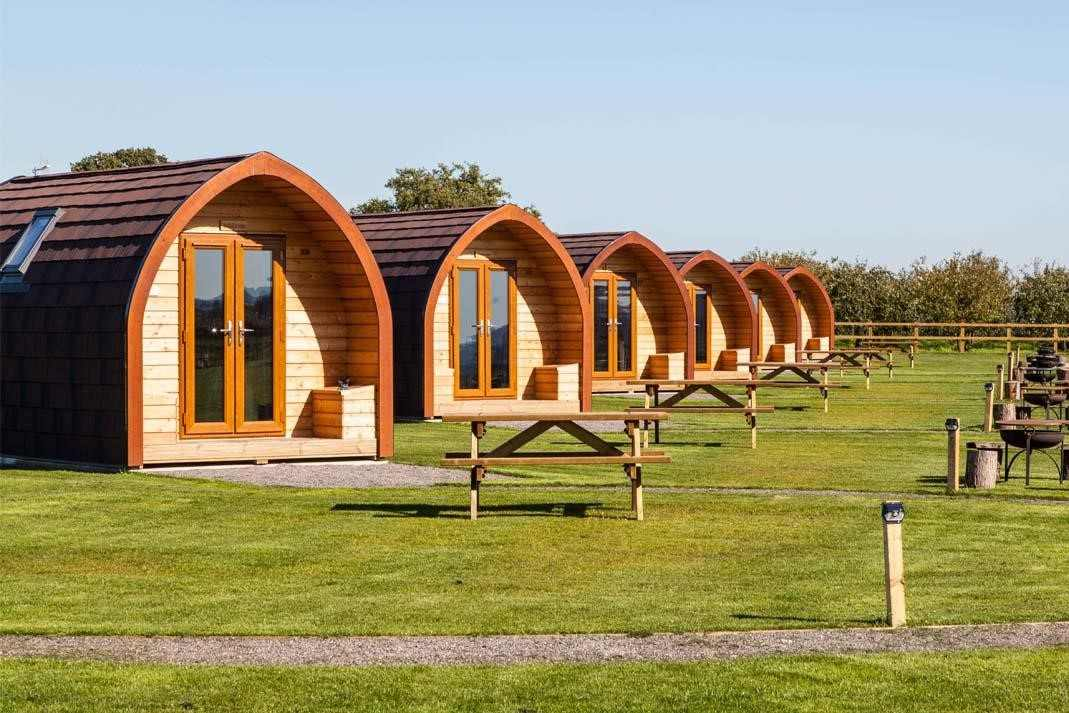 row-of-rankins-farm-glamping-pods-in-field