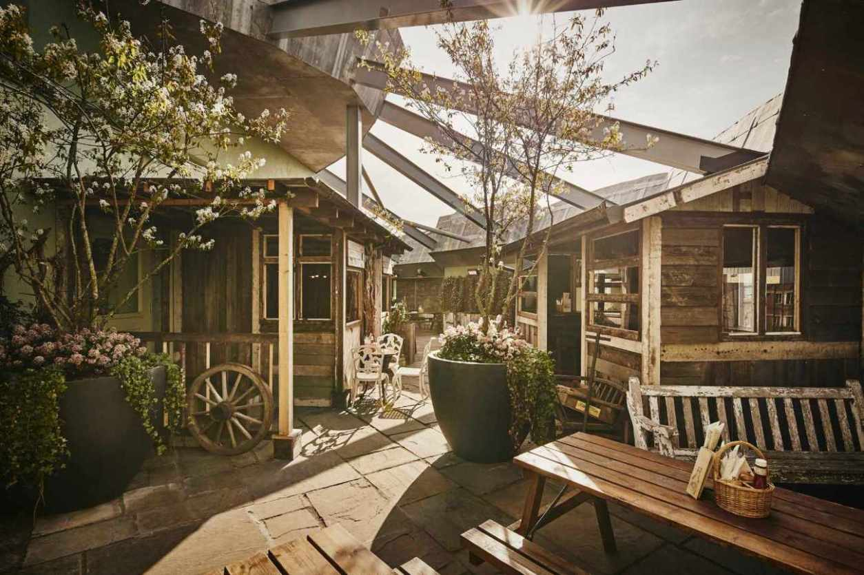 the-botanist-roof-garden-with-wooden-chalets