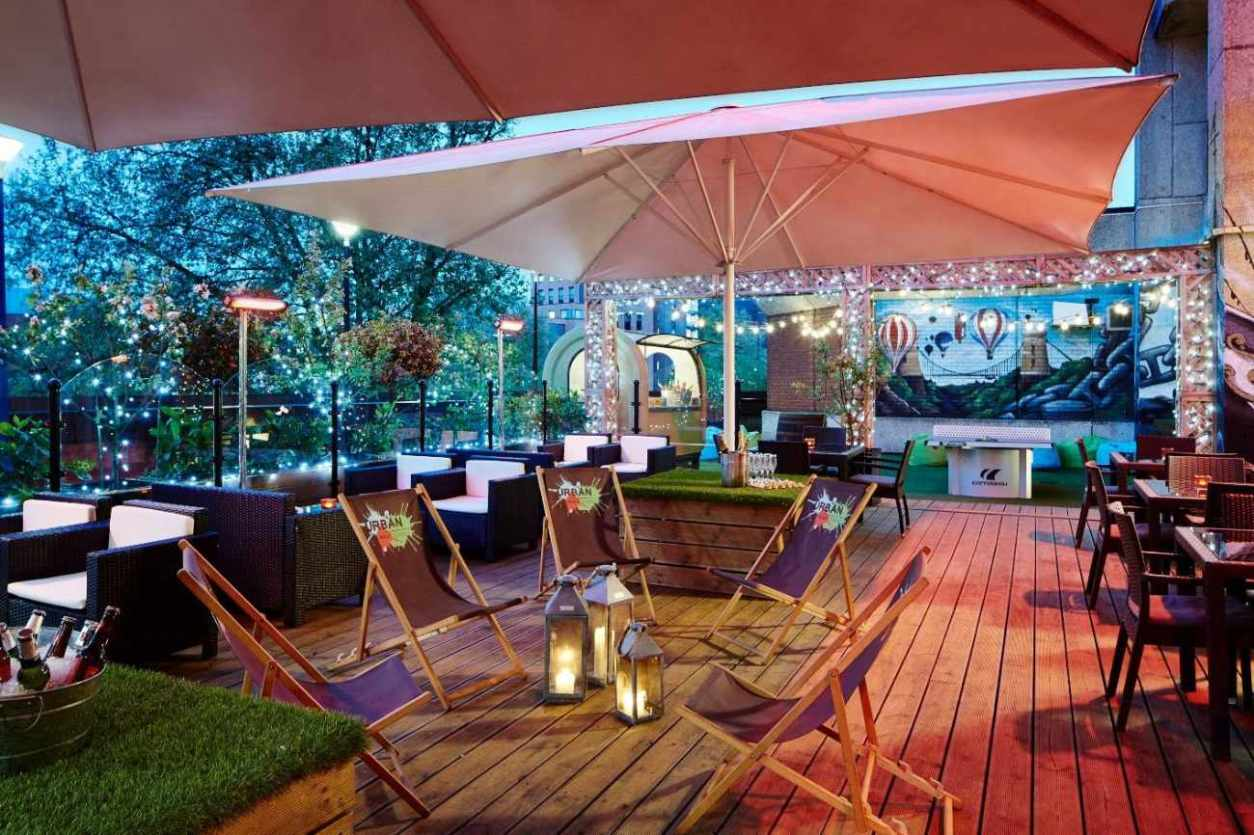 urban-roof-terrace-lit-up-at-night-rooftop-bars-bristol