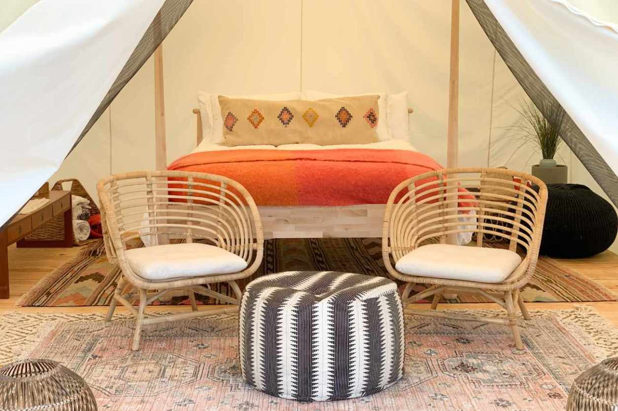 double-bed-and-seating-inside-surya-nature-retreat-tent