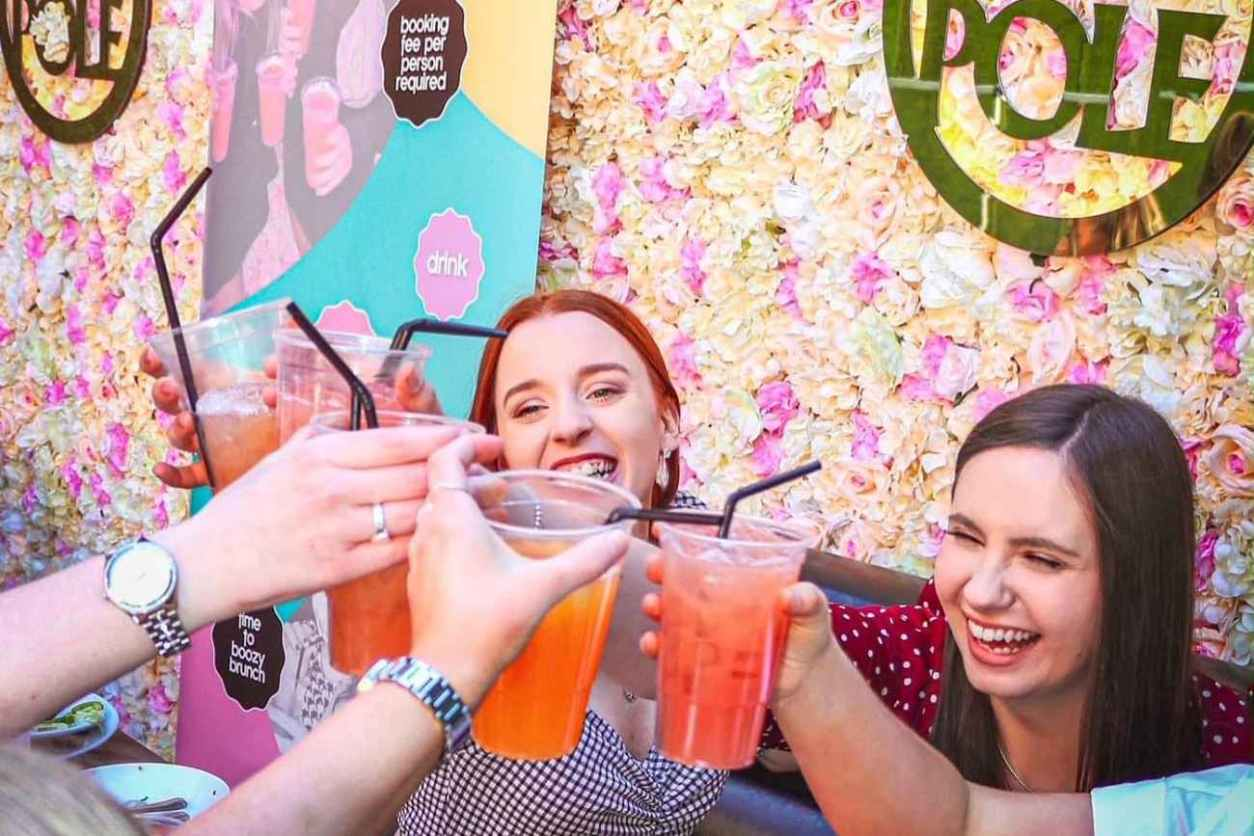 friends-cheersing-drinks-at-love-brunch