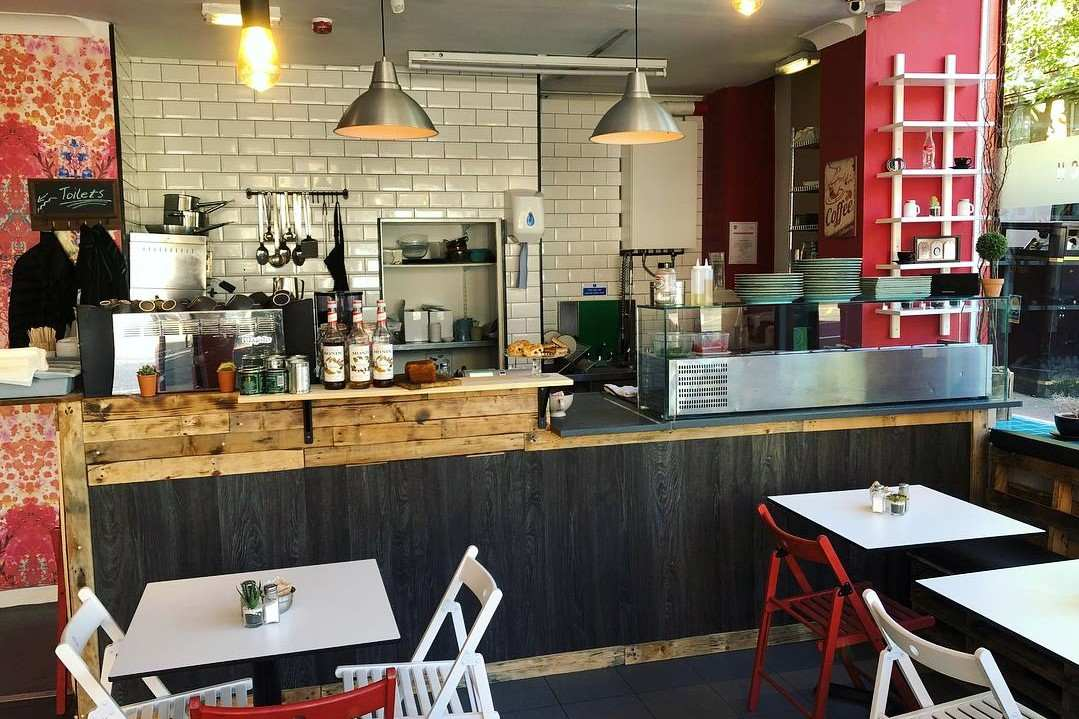interior-of-urban-west-cafe-with-counter-and-tables