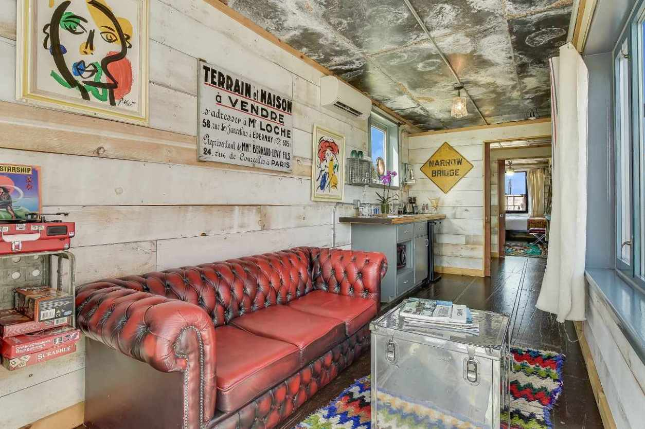 living-room-and-kitchen-of-flophouze-shipping-container-hotel