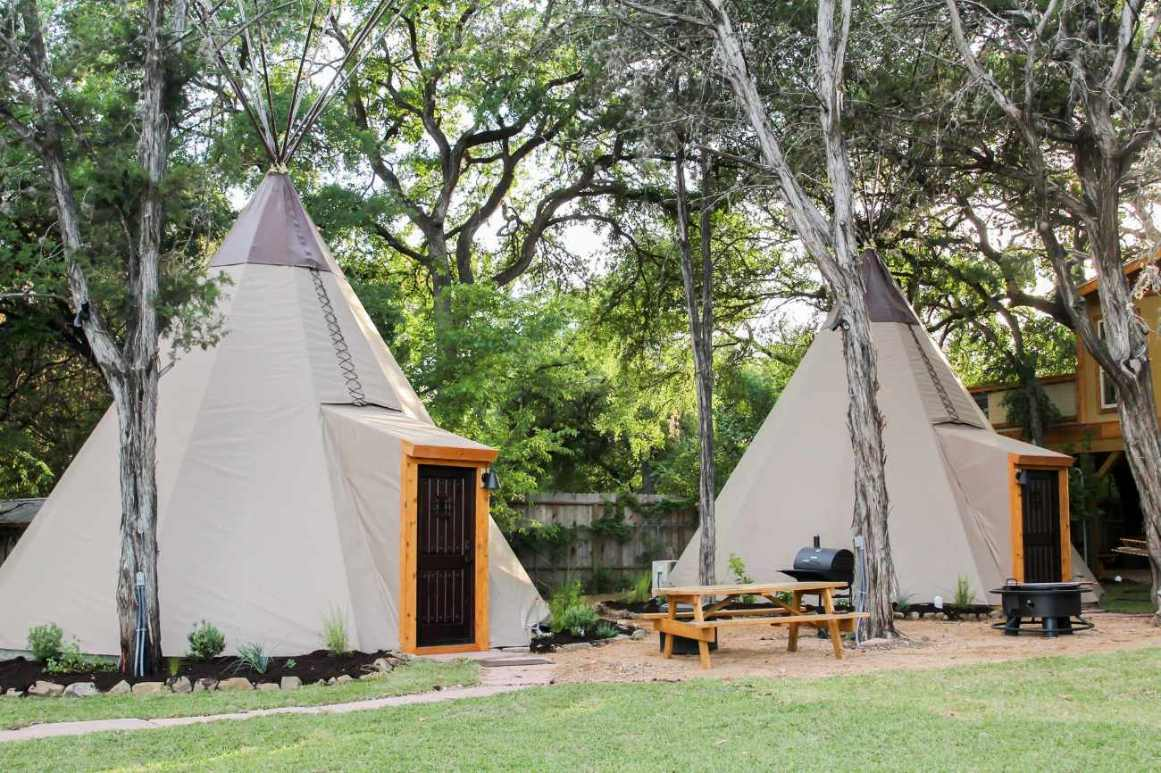two-tipis-on-the-guadalupe-in-field