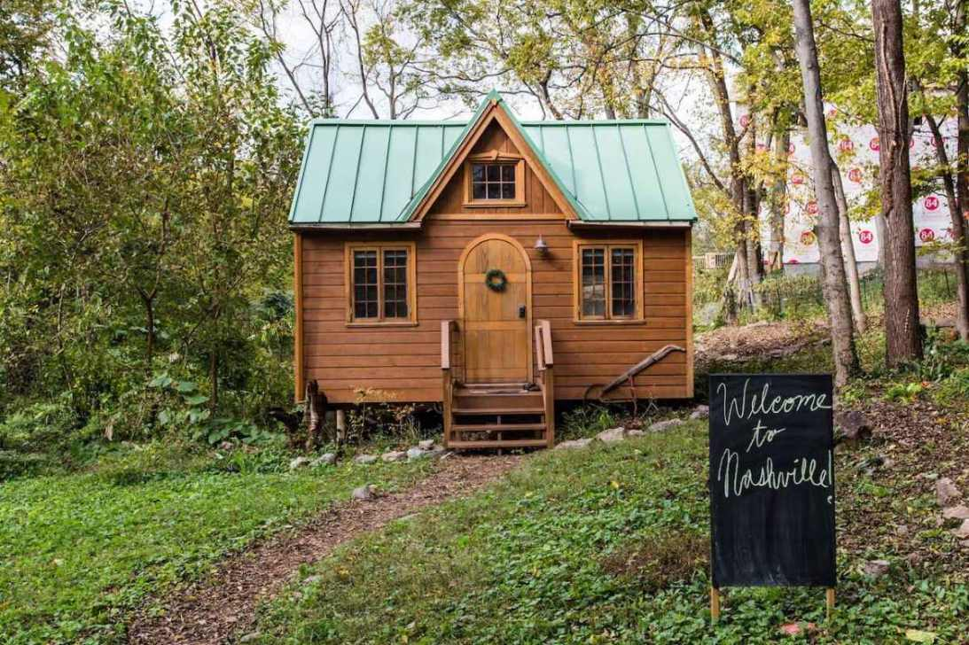 exterior-of-dreamy-tiny-house-in-woodland