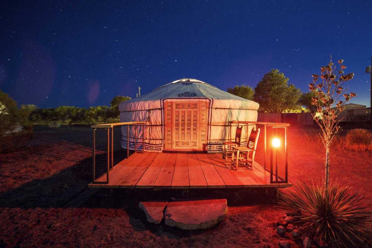 exterior-of-el-cosmico-yurt-at-night-yurts-texas