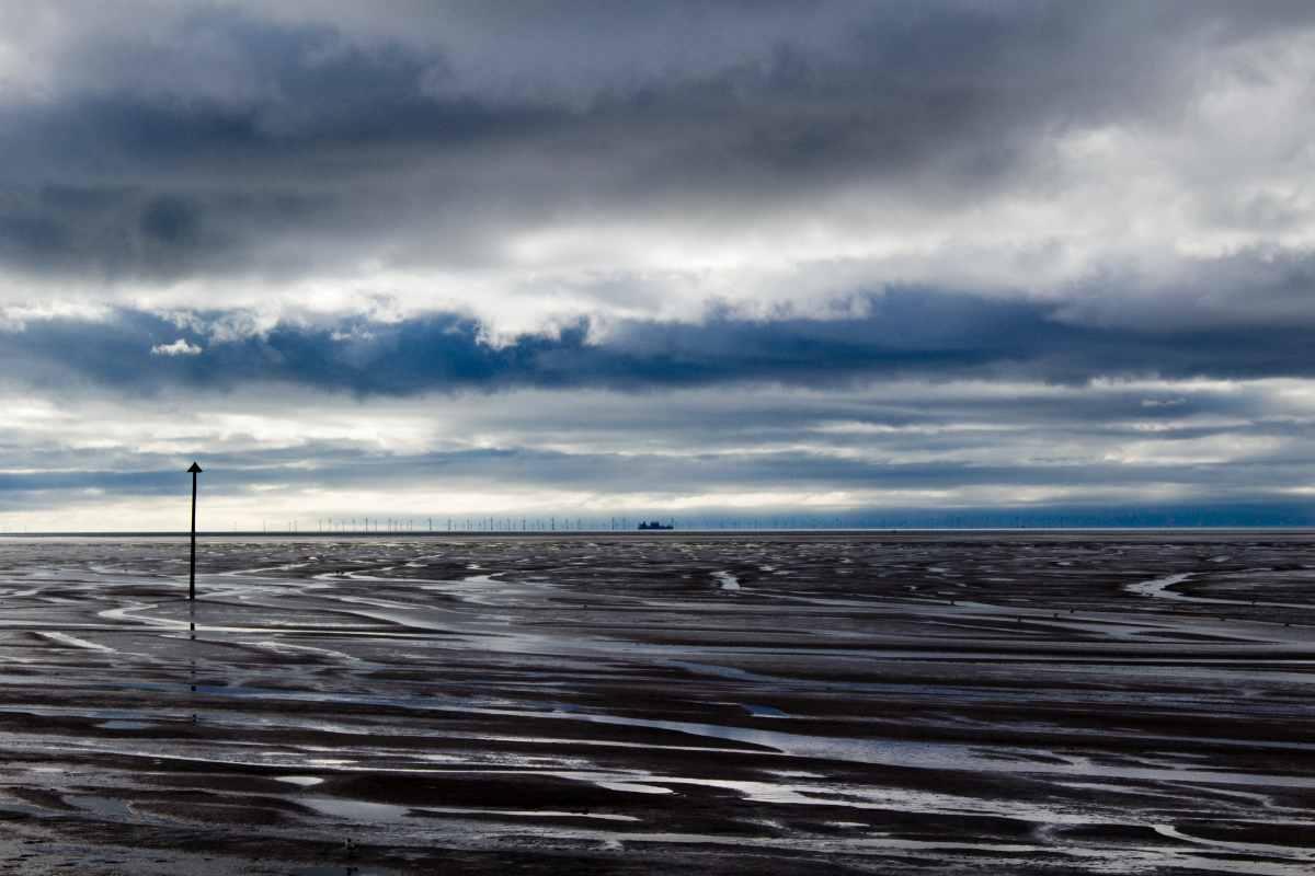 hoylake-beach-on-dark-cloudy-day