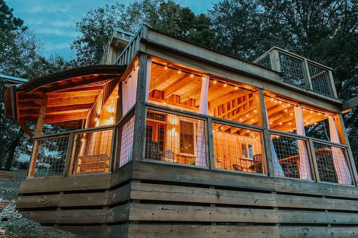 little-river-tiny-house-lit-up-at-night-glamping-tennessee