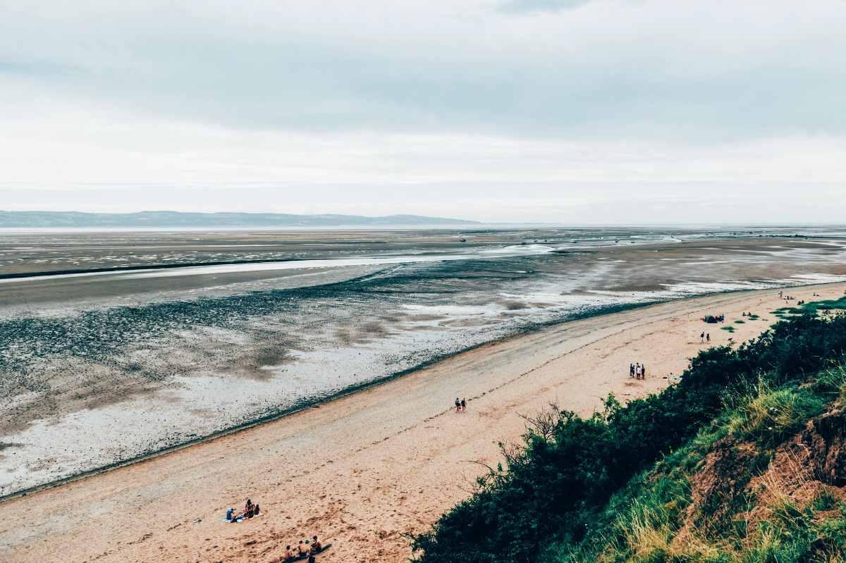 people-walking-down-thurstaston-beach-beaches-in-liverpool
