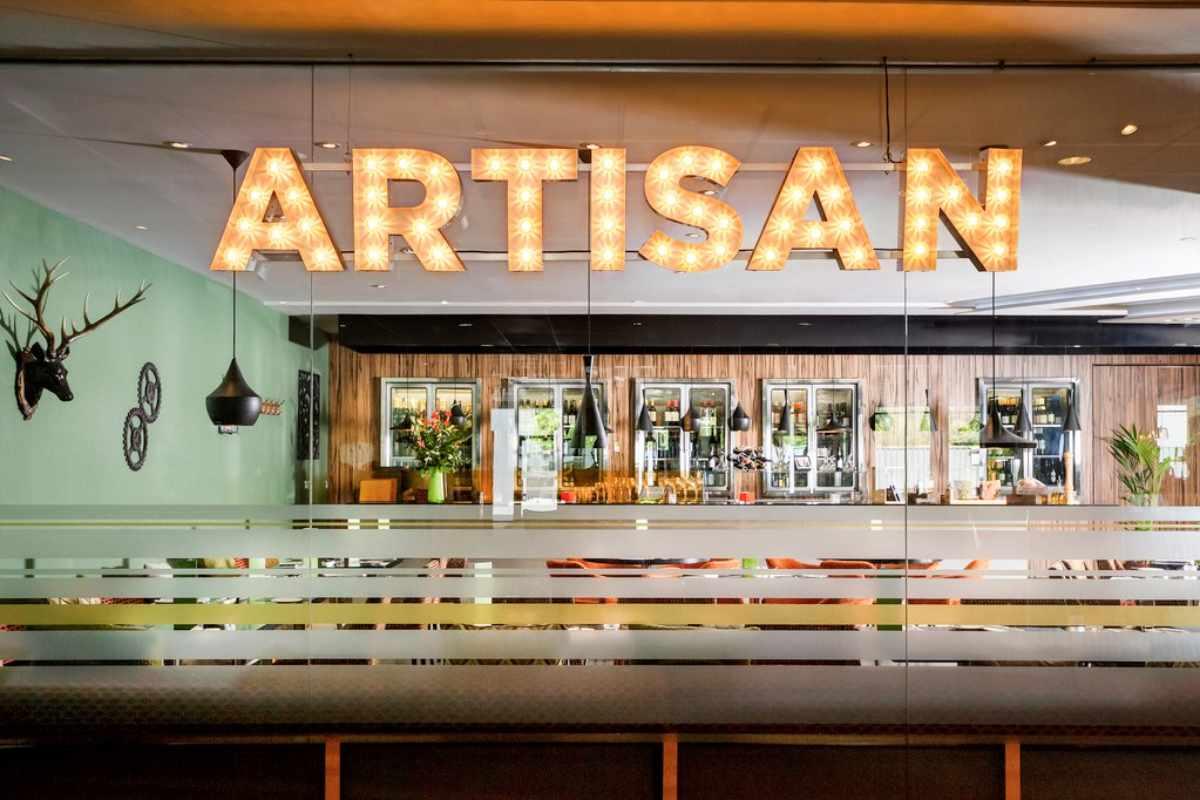 artisan-sign-on-wall-of-restaurant
