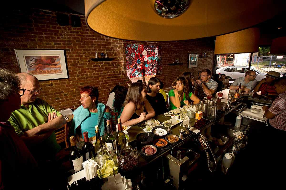 people-eating-and-drinking-at-bar-of-fonda-restaurant