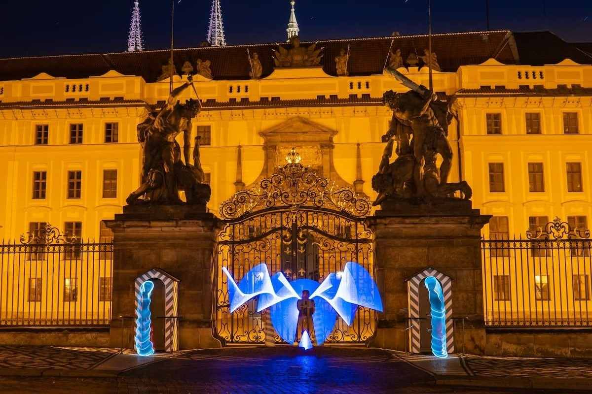 person-in-front-of-palace-on-light-painting-tour-things-to-do-in-prague-at-night