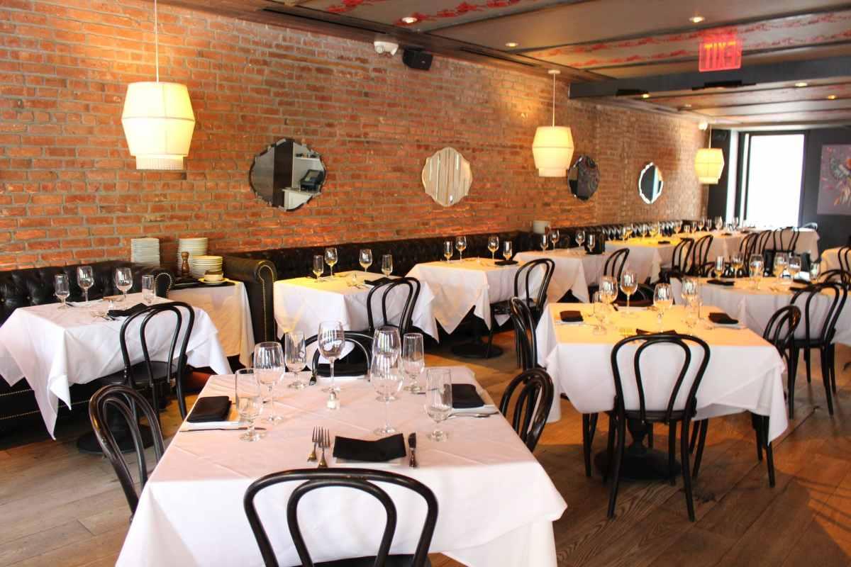 restaurant-tables-by-brick-wall-inside-bocca-di-bacco
