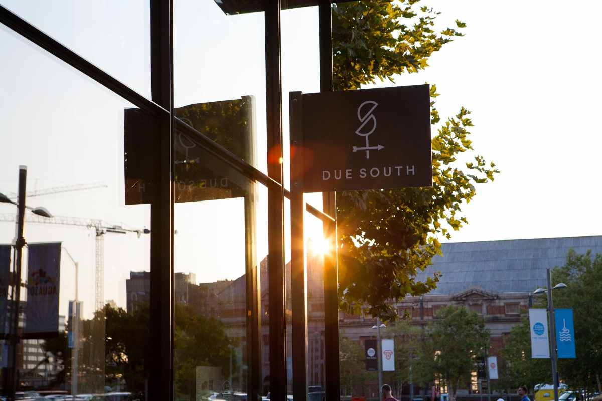 sign-outside-due-south-restaurant-at-sunset