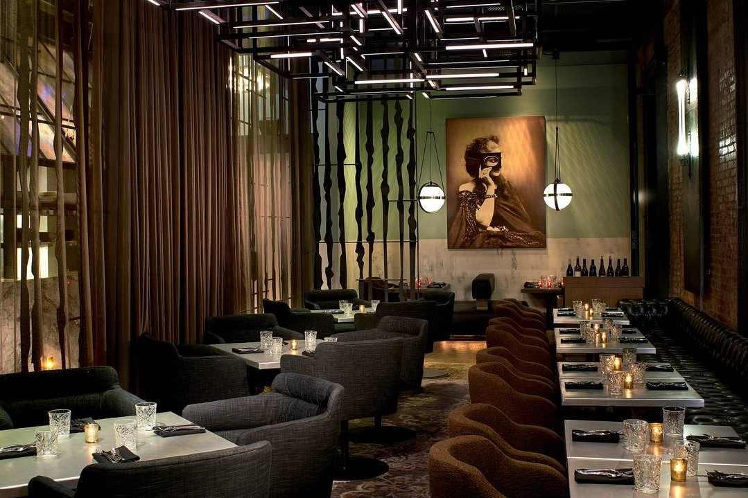 tables-inside-dirty-habit-restaurant-at-night-bottomless-brunch-dc