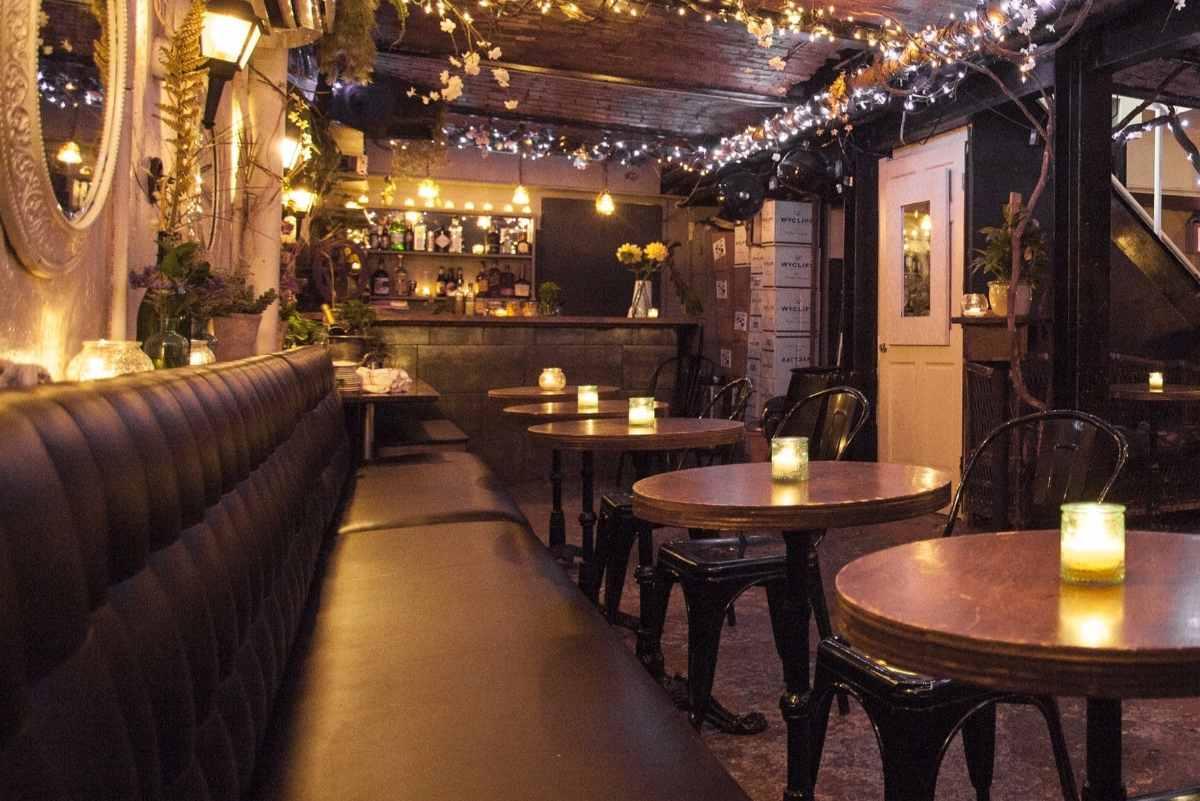 tables-inside-poco-restaurant-at-night