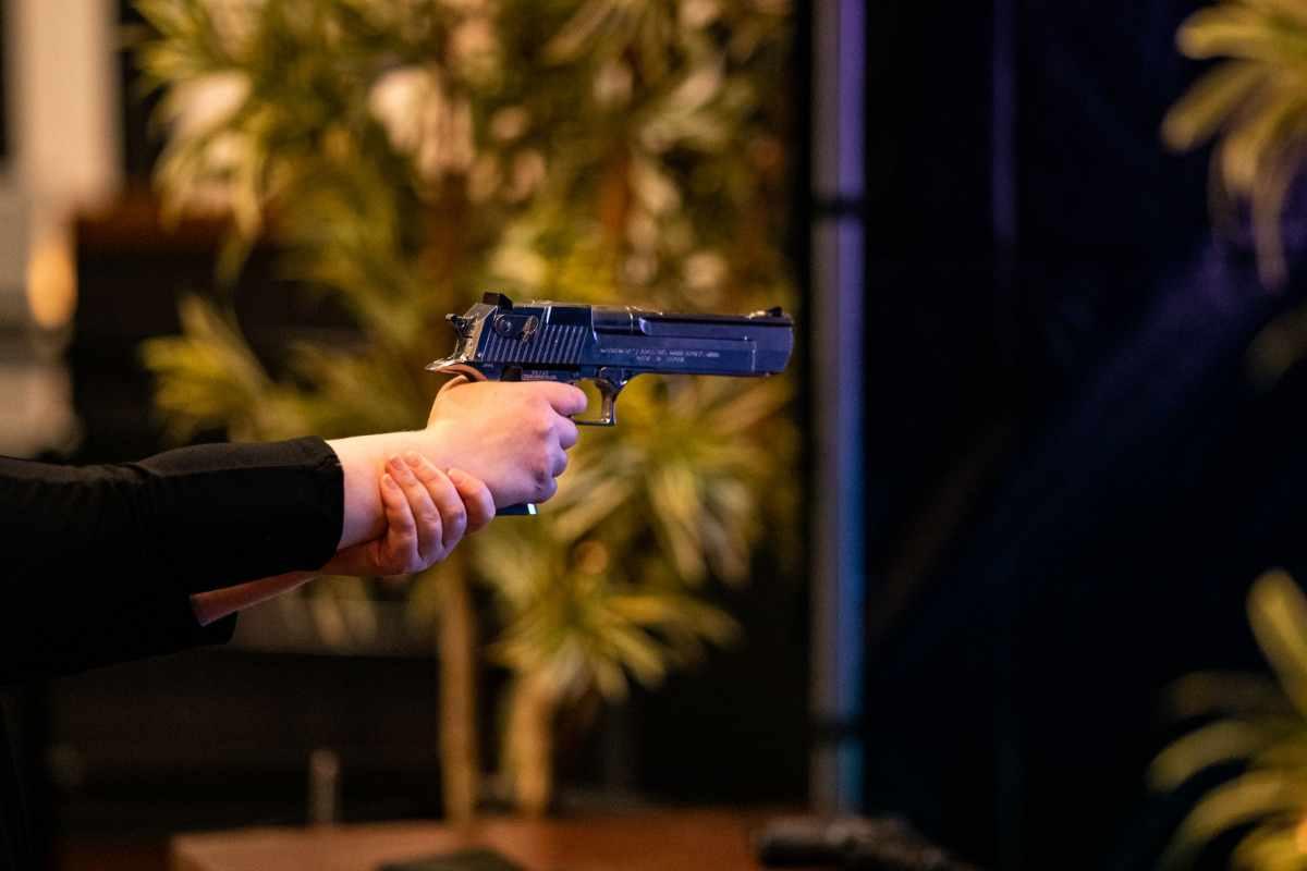 hand-shooting-gun-at-point-blank-shooting-bar