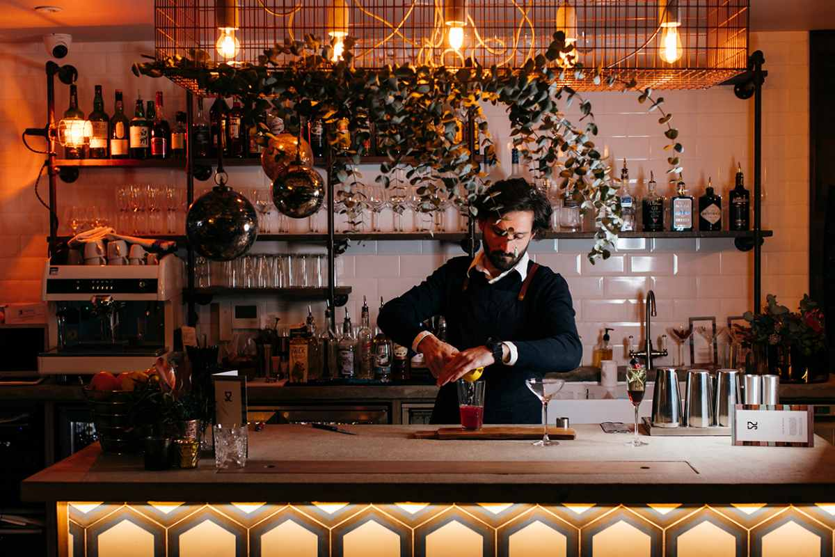 man-making-cocktail-behind-bar-of-project-52