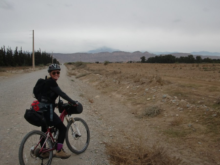 Gravel track with Atlas Mountains in the distance The hungry biker