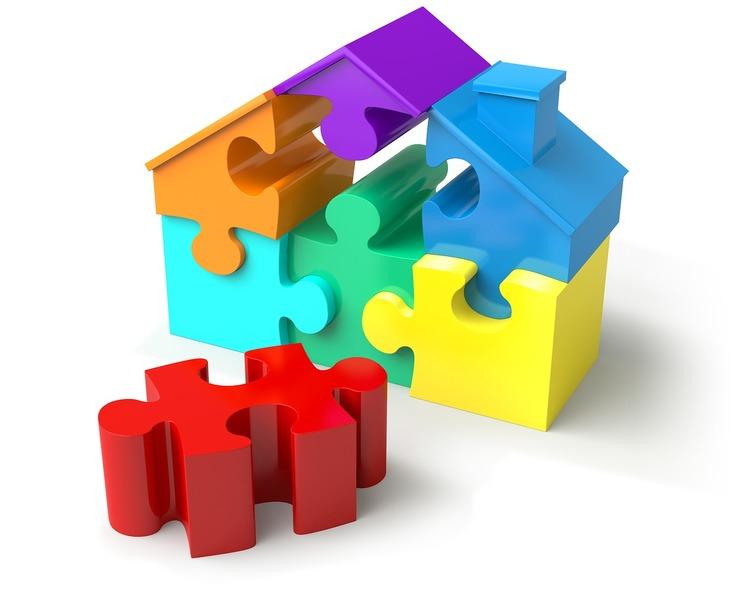 Casa fatta di pezzi di puzzle: ogni pezzo rappresenta una competenza