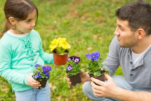 Father and daughter with lawn & garden supplies