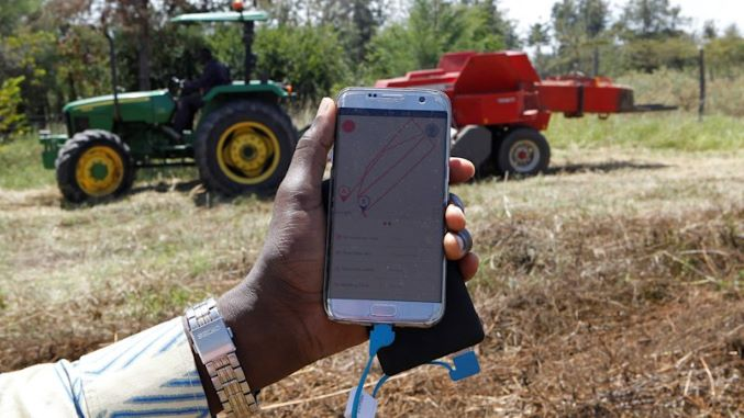 John Deere taps tractor-hailing tech for farmers in Africa