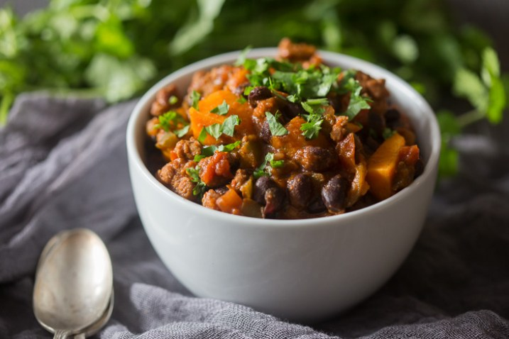 This spicy chorizo sweet potato black bean chili is ready in just 30 minutes and is packed full of hearty deliciousness. Top with cilantro and call it dinner!