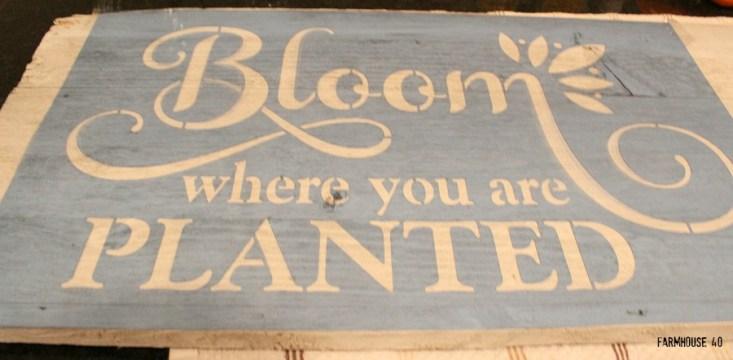 wood stenciled bloom sign