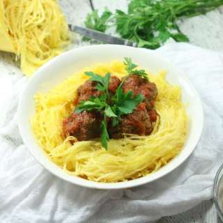 These giant-sized Paleo & Whole30 Italian Meatballs with Spaghetti Squash are tasty, healthy and easy to make in the slow cooker for a fuss-free dinner!