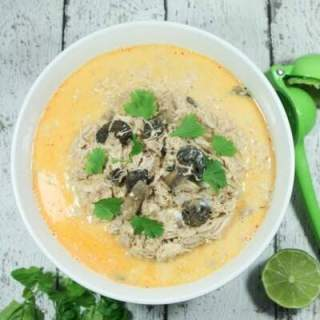 Creamy and spicy with hints of lime, this easy + healthy Paleo and Whole30 Coconut Curry Chicken Soup is the perfect slow cooker meal.