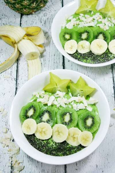These Paleo and Whole30 Tropical Avocado Smoothie Bowls are on point. Smooth and creamy, they're the perfect detox breakfast after a weekend of cheat meals.