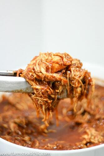 This Paleo and Whole30 Slow Cooker Pulled Barbecue Chicken is legit. It's full of flavor, super-simple to make, easy on the budget and Paleo and Whole30-friendly. Grain-free, gluten-fee, dairy-free and all that jazz, too.
