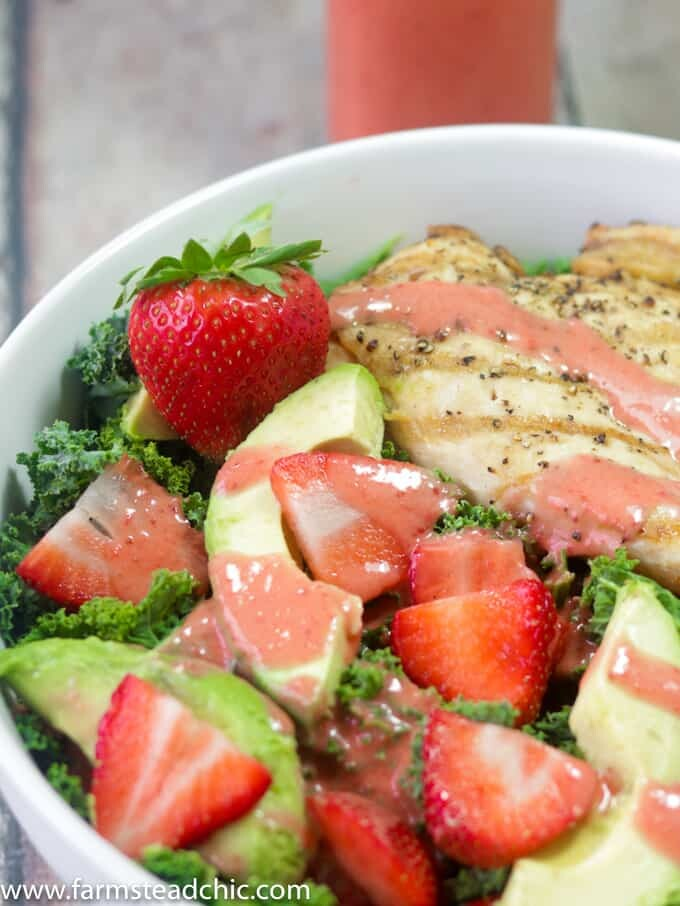 This Paleo and Whole30 Strawberry Avocado Kale Salad has a base of kale. Add grilled chicken to make it a full meal and drizzle with Strawberry Vinaigrette. A simple gluten free, grain free and dairy free superfood meal! Leave off the chicken for a vegetarian and vegan side salad.